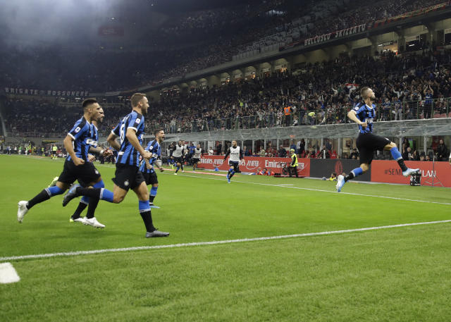 Inter Milan's Marcelo Brozovic, right, celebrates his opening goal during a Serie A soccer match between AC Milan and Inter Milan, at the San Siro stadium in Milan, Italy, Saturday, Sept.21, 2019. (AP Photo/Luca Bruno)