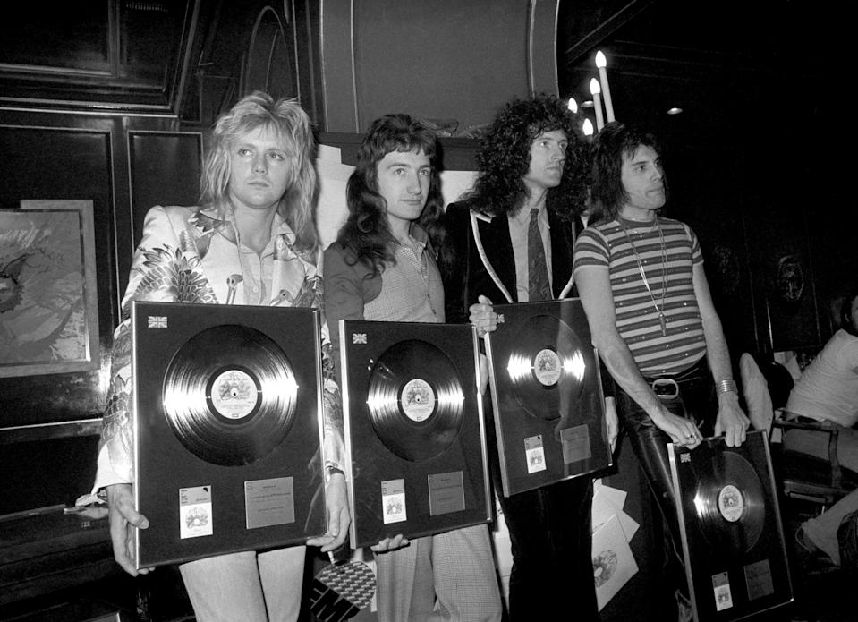 Queen rock band, Roger Taylor, John Deacon, Brian May and Freddie Mercury, with silver, gold and platinum awards they received from the British Phonographic Institute, for the sales of Bohemian Rhapsody and two albums (PA)