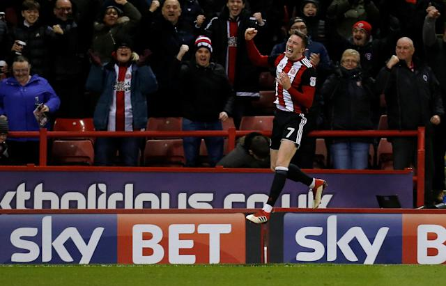 "Soccer Football - Championship - Sheffield United vs Queens Park Rangers - Bramall Lane, Sheffield, Britain - February 20, 2018 Sheffield United's John Lundstram celebrates scoring their second goal Action Images/Ed Sykes EDITORIAL USE ONLY. No use with unauthorized audio, video, data, fixture lists, club/league logos or ""live"" services. Online in-match use limited to 75 images, no video emulation. No use in betting, games or single club/league/player publications. Please contact your account representative for further details."