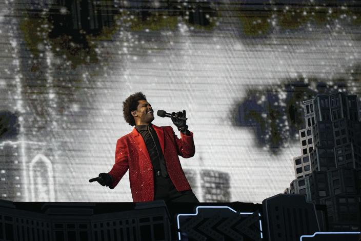 The Weeknd performs during the halftime show of the NFL Super Bowl 55 football game between the Kansas City Chiefs and Tampa Bay Buccaneers, Sunday, Feb. 7, 2021, in Tampa, Fla. (AP Photo/David J. Phillip)