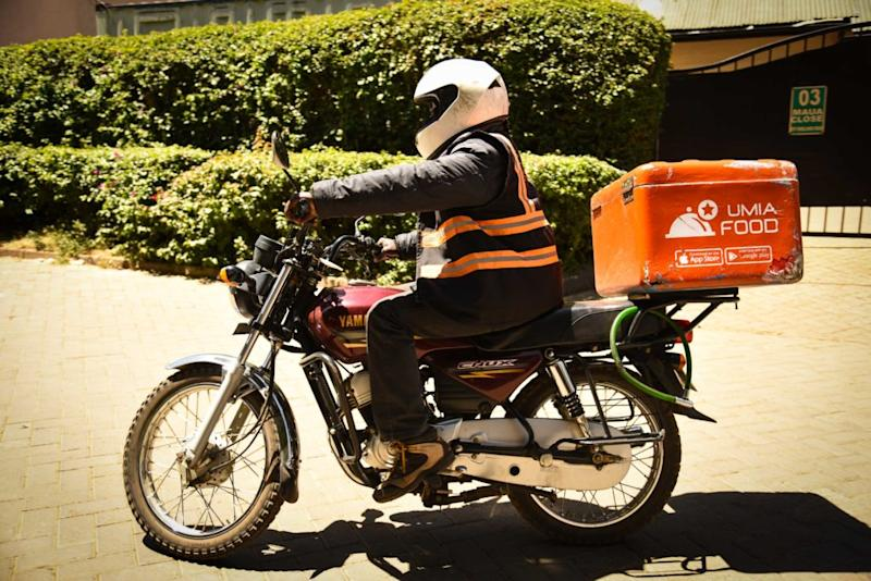 A motorbike driver delivering a Jumia package.