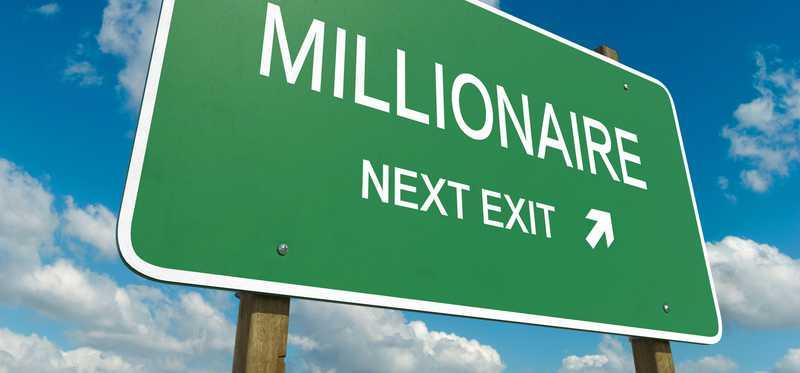Road sign that says Millionaire Next Exit.