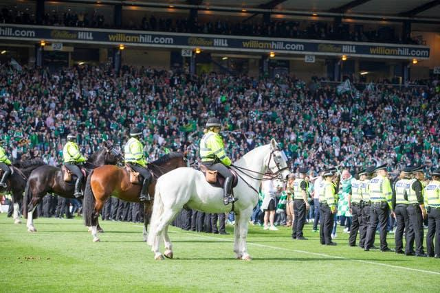 Police patrol the Hampden Park pitch