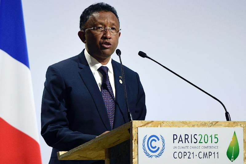 Madagascar's President  Hery  Rajaonarimampianina  delivers a speech during the opening day of the World Climate Change Conference 2015 (COP21), on November 30, 2015 at Le Bourget, on the outskirts of the French capital Paris