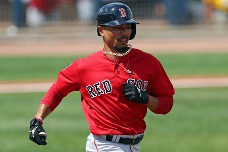 Mar 10, 2019; Port Charlotte, FL, USA; Boston Red Sox right fielder Mookie Betts (50) grounds out against the Tampa Bay Rays in the fourth inning at Charlotte Sports Park. Mandatory Credit: Aaron Doster-USA TODAY Sports