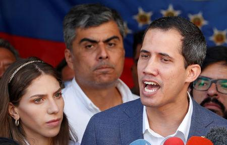 FILE PHOTO: Venezuelan opposition leader Juan Guaido, who many nations have recognized as the country's rightful interim ruler, talks to the media after attending a religious event in Caracas, Venezuela February 10, 2019. REUTERS/Carlos Garcia Rawlins/File Photo