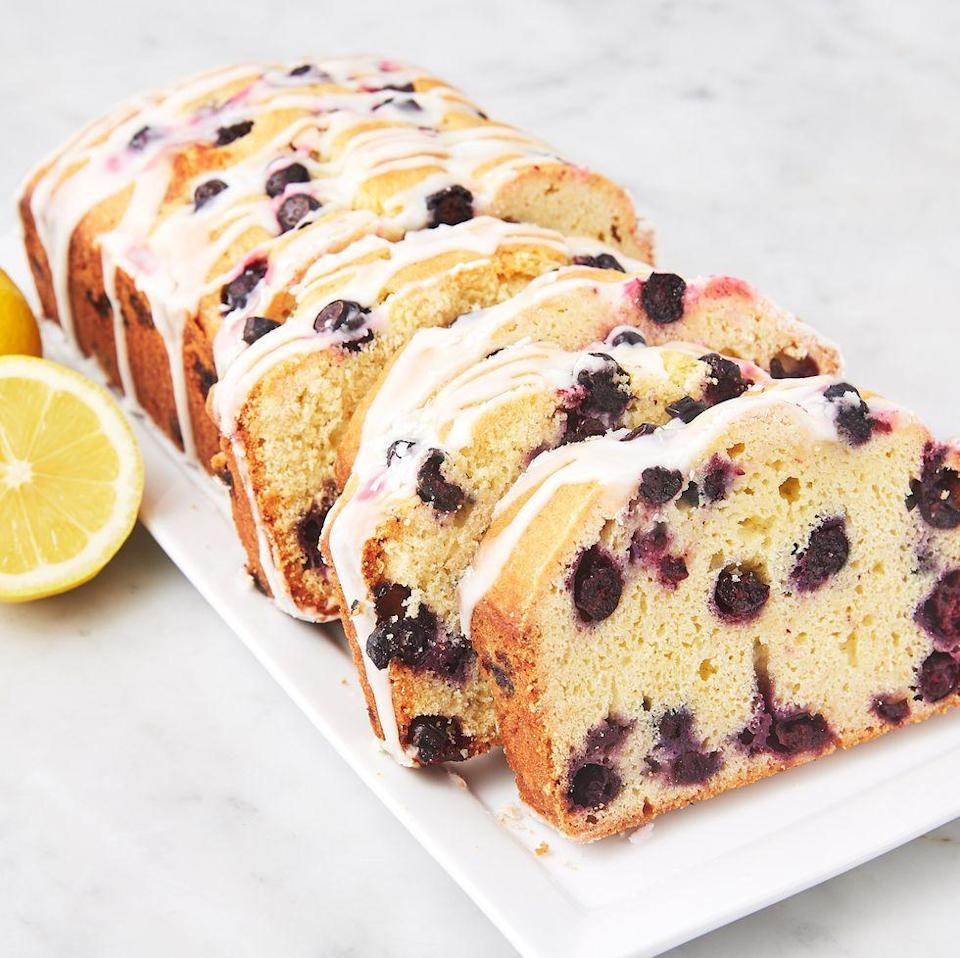 """<p>We're in LOVE with this spring-y loaf cake. The sweet and buttery cake pairs beautifully with its tart glaze. It's worth turning your oven on for, even on a hot summer day. </p><p>Get the <a href=""""https://www.delish.com/uk/cooking/recipes/a35187302/lemon-blueberry-pound-cake-recipe/"""" rel=""""nofollow noopener"""" target=""""_blank"""" data-ylk=""""slk:Lemon-Blueberry Loaf Cake"""" class=""""link rapid-noclick-resp"""">Lemon-Blueberry Loaf Cake</a> recipe.</p>"""