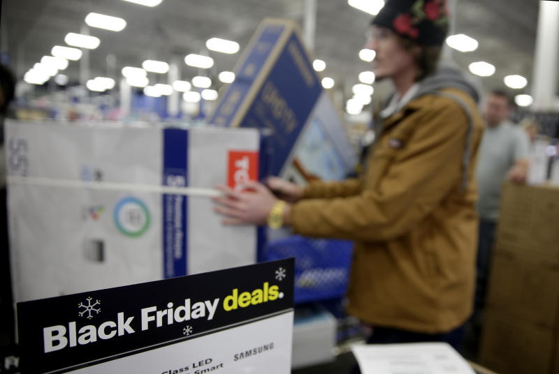 People wait in line to buy televisions as they shop during an early Black Friday sale at a Best Buy store on Thanksgiving Day Thursday, Nov. 22, 2018, in Overland Park, Kan. (AP Photo/Charlie Riedel)