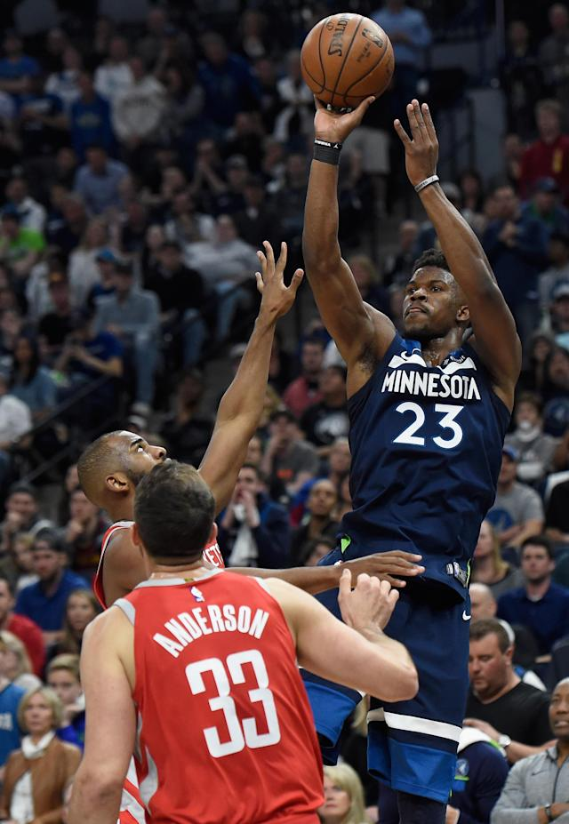 MINNEAPOLIS, MN - APRIL 21: Jimmy Butler #23 of the Minnesota Timberwolves shoots the ball against Chris Paul #3 and Ryan Anderson #33 of the Houston Rockets during the fourth quarter in Game Three of Round One of the 2018 NBA Playoffs on April 21, 2018 at the Target Center in Minneapolis, Minnesota. The Timberwolves defeated 121-105. (Photo by Hannah Foslien/Getty Images)