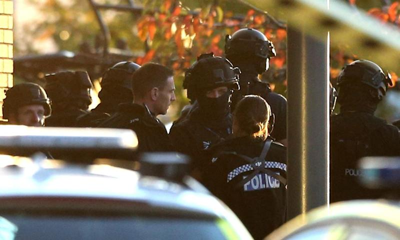 Armed police at the scene in Bermuda Park, Nuneaton.