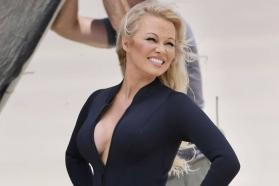 Pamela Anderson recreates 'Baywatch' vibe as she runs in skin-tight wetsuit