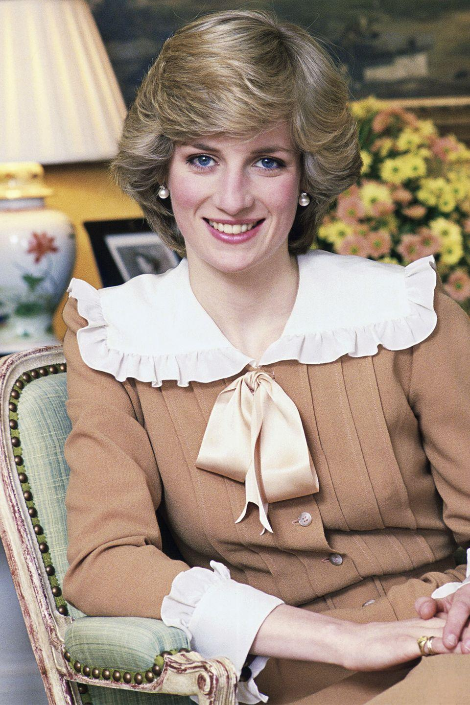 <p>In an official royal portrait from Kensington Palace with her hair perfectly swept away from her face. </p>