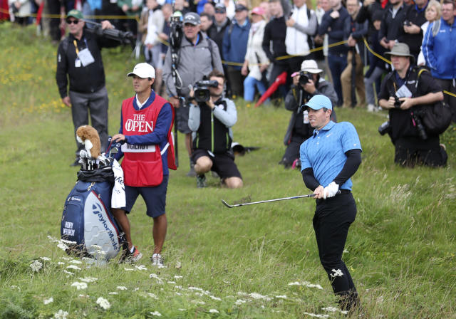Northern Ireland's Rory McIlroy looks up after playing out of the long rough on the 1st hole during the first round of the British Open Golf Championships at Royal Portrush in Northern Ireland, Thursday, July 18, 2019.(AP Photo/Peter Morrison)