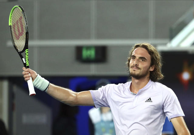 Stefanos Tsitsipas of Greece celebrates after defeating Italy's Salvatore Caruso in their first round singles match at the Australian Open tennis championship in Melbourne, Australia, Monday, Jan. 20, 2020. (AP Photo/Dita Alangkara)