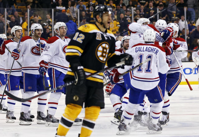 Montreal Canadiens teammates jump on P.K. Subban, right, after his game-winning goal in the second overtime period as Boston Bruins right wing Jarome Iginla (12) skates away in Game 1 of an NHL hockey second-round playoff series in Boston, Thursday, May 1, 2014. (AP Photo/Elise Amendola)