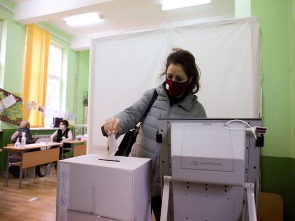 A woman votes in a polling station during the parliamentary election in Bulgaria (Photo/Credit: Reuters Image)