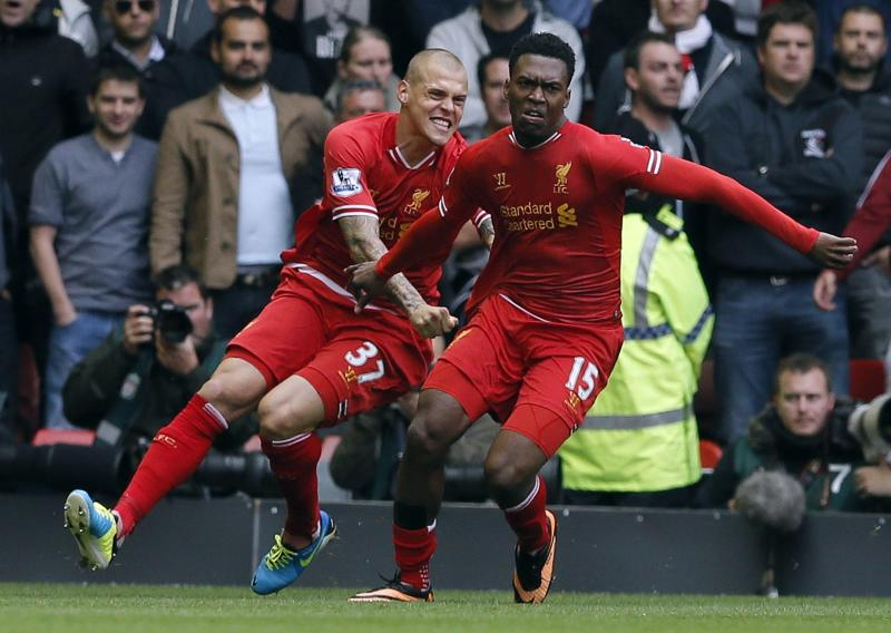 Liverpool's Sturridge celebrates scoring against Manchester United with Martin Skrtel during their English Premier League soccer match at Anfield