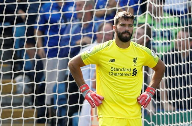 Alisson looks dejected after his mistake allowed Leicester a lifeline