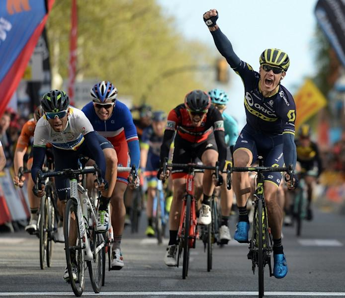 Orica's South African cyclist Daryl Impey (R) celebrates his victory as he crosses the finish line followed by Movistar's Spanish rider Alejandro Valverde (L) on the sixth day of the 97th Volta Catalunya 2017 in Reus on March 25, 2017