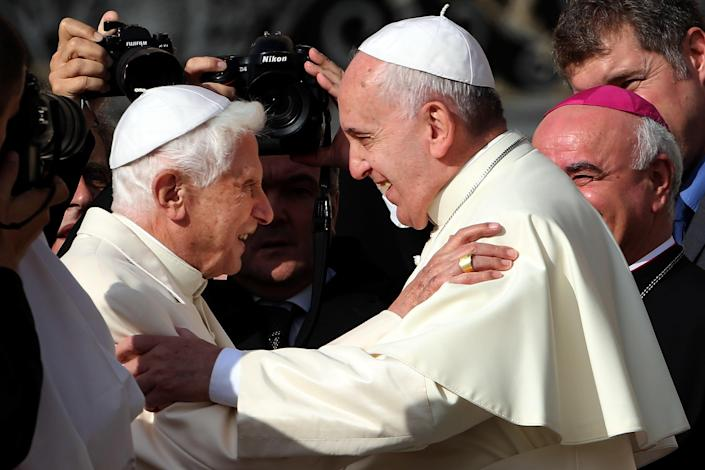 Pope Francis, right, greets Pope Emeritus Benedict XVI at St. Peter's Basilica at the Vatican on September 28, 2014. / Credit: Franco Origlia/Getty