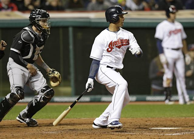 Cleveland Indians' Michael Brantley, front right, hits a two-RBI single off Chicago White Sox relief pitcher Maikel Cleto in the sixth inning of a baseball game on Friday, May 2, 2014, in Cleveland. Indians' Nick Swisher and Carlos Santana scored. White Sox catcher Adrian Nieto, left, watches. (AP Photo/Tony Dejak)
