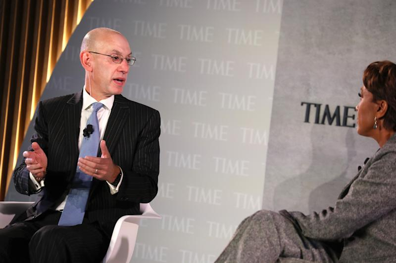 NEW YORK, NEW YORK - OCTOBER 17: Commissioner of the NBA, Adam Silver (L) and broadcaster Robin Roberts speak onstage during the TIME 100 Health Summit at Pier 17 on October 17, 2019 in New York City. (Photo by Brian Ach/Getty Images for TIME 100 Health Summit )