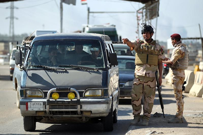 Iraqi soldiers man a checkpoint at the entrance to the Abu Ghraib area west of the Iraqi capital Baghdad on February 29, 2016
