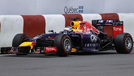 Red Bull Formula One driver Sebastian Vettel of Germany pilots his car next to a barrier during the qualifying session of the Canadian F1 Grand Prix at the Circuit Gilles Villeneuve in Montreal June 7, 2014. REUTERS/Mathieu Belanger