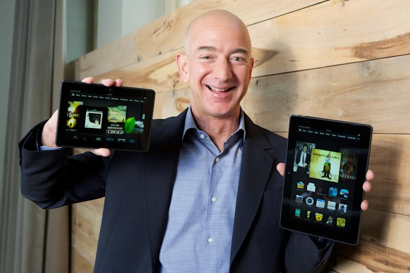 IMAGE DISTRIBUTED FOR AMAZON – In this image distributed on Tuesday, Sept. 24, 2013, Amazon.com Founder and CEO Jeff Bezos introduces the all-new Kindle Fire HDX 8.9'', right, and Kindle Fire HDX 7'' tablet in Seattle.""