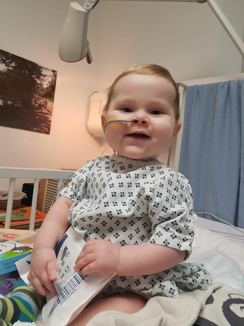 Callan Price, now 17 months old, at the Evelina Children's hospital in London 6 days aftyer his transplant. See SWNS copy SWCAliver: A baby who was poisoning his own brain was saved by his dad who underwent a 10-hour operation to donate part of his liver. Little Callan Price, now 17-months-old, was rushed away by doctors when he was first born and fell into a coma when he was four-days-old. His distraught parents Matt Price, 39 and his wife Jen Price, 36, were told the devastating news that their baby boy may not make it through the night.