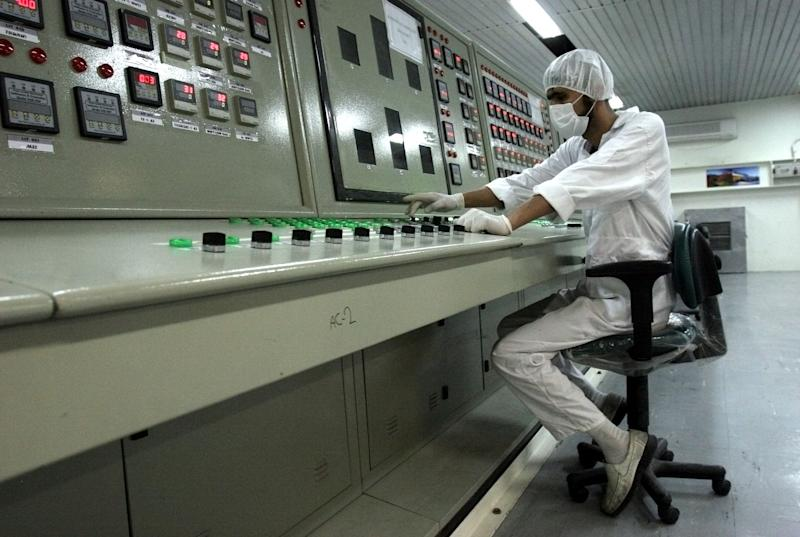 FILE - In this Saturday, Feb. 3, 2007 file photo, an Iranian technician works at the uranium conversion facility just outside the city of Isfahan 255 miles (410 kilometers) south of the capital Tehran, Iran.  Iran has floated specific dates for reopening talks with the U.S. and other world powers about its nuclear program. At the same time, Tehran has left U.N. nuclear inspectors empty-handed when it comes to addressing Western suspicions that it's conducting tests related to nuclear weapons. (AP Photo/Vahid Salemi, File)