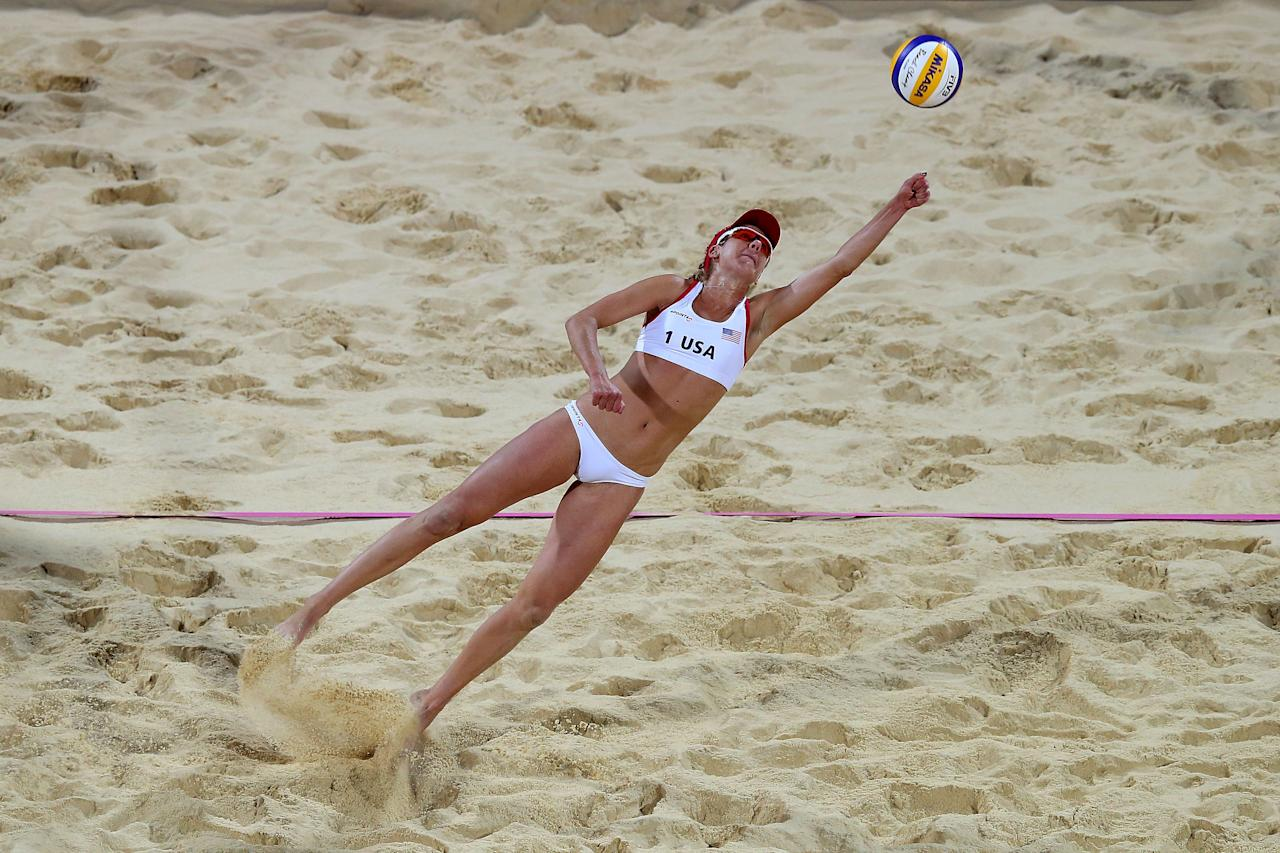 LONDON, ENGLAND - AUGUST 08:  April Ross of the United States lunges for the ball in the Women's Beach Volleyball Gold medal match against the United States on Day 12 of the London 2012 Olympic Games at the Horse Guard's Parade on August 8, 2012 in London, England.  (Photo by Ryan Pierse/Getty Images)