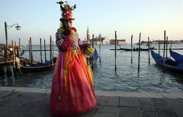 A masked reveler poses in Saint Mark's Square during the Venetian Carnival in Venice February 12, 2012.