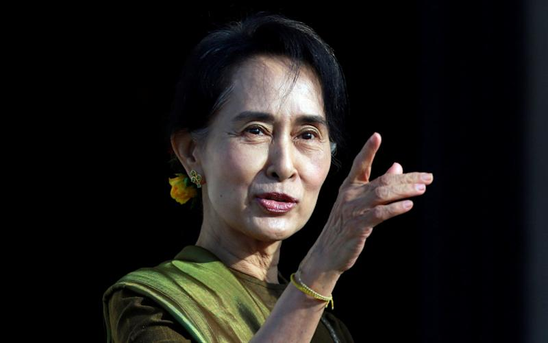 Aung San Suu Kyi will personally defend her country against genocide charges  - Reuters