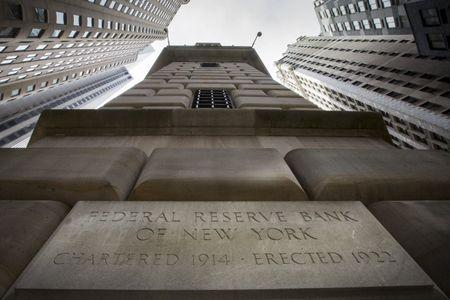 The corner stone of The New York Federal Reserve Bank is seen surrounded by financial institutions in New York's financial district March 25, 2015. REUTERS/Brendan McDermid