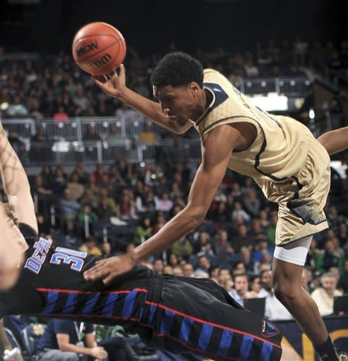Notre Dame guard Cameron Biedscheid, right, collides with DePaul forward Peter Ryckbosch during the first half of an NCAA college basketball game Wednesday, Feb. 13, 2013, in South Bend, Ind. (AP Photo/Joe Raymond)