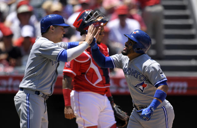 Toronto Blue Jays' Devon Travis, right, is congratulated by Aledmys Diaz after hitting a three-run home run during the second inning of a baseball game against the Los Angeles Angels Sunday, June 24, 2018, in Anaheim, Calif. (AP Photo/Mark J. Terrill)