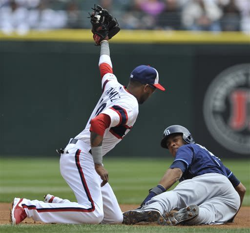 Chicago White Sox shortstop Alexei Ramirez, left, tags out Tampa Bay Rays' Desmond Jennings who was attempting to steal second base during the first inning of a baseball game in Chicago, Sunday, April 28, 2013. (AP Photo/Paul Beaty)