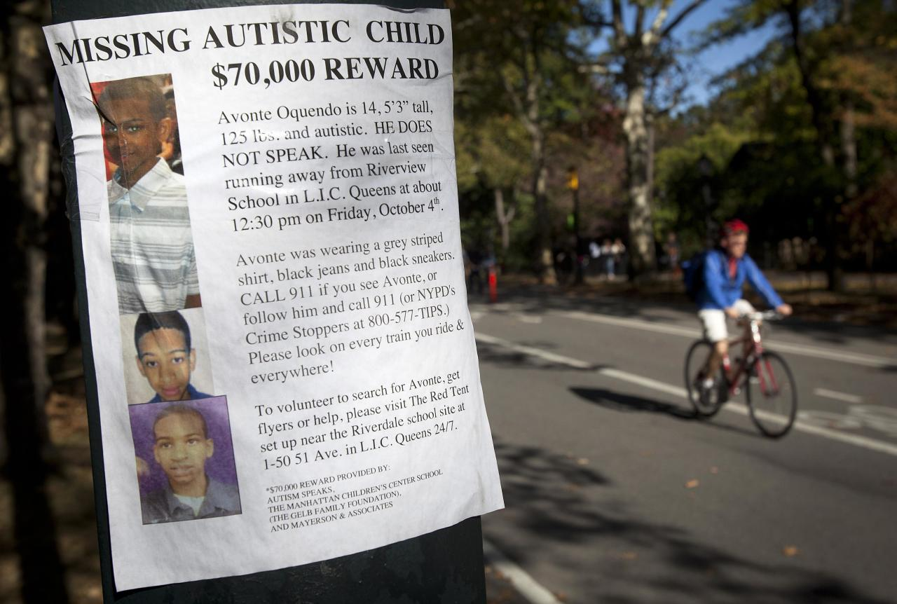 A missing poster is taped to a pole in Central Park for Avonte Oquendo, a 14-year-old autistic youth, in New York October 20, 2013. Oquendo has been missing for two weeks since walking out of his school, and a $70,000 reward has been offered for his safe return. REUTERS/Carlo Allegri (UNITED STATES - Tags: SOCIETY)