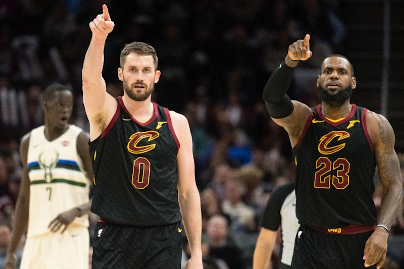 LeBron James unleashed his 16th triple-double and Kevin Love played his first game since breaking his left hand on January 30, as the Cavaliers ran out 124-117 winners over Milwaukee (AFP Photo/Jason Miller)