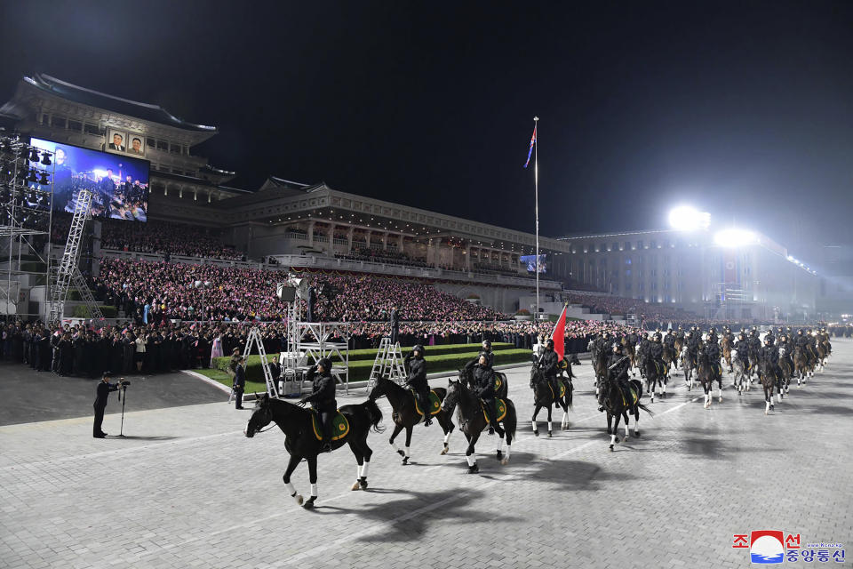 """In this photo provided by the North Korean government, North Korean soldiers on horses parade during a celebration of the nation's 73rd anniversary that was overseen by leader Kim Jong Un, at Kim Il Sung Square in Pyongyang, North Korea, early Thursday, Sept. 9, 2021. Independent journalists were not given access to cover the event depicted in this image distributed by the North Korean government. The content of this image is as provided and cannot be independently verified. Korean language watermark on image as provided by source reads: """"KCNA"""" which is the abbreviation for Korean Central News Agency. (Korean Central News Agency/Korea News Service via AP)"""