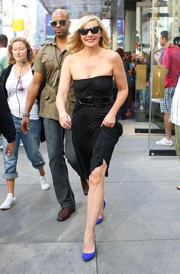 "Also in attendance ... gorgeous 53-year-old Kim Cattrall (Samantha Jones), who showed off her ageless bod in a simple belted LBD, electric blue pumps, and Ray-Ban shades. Jay Thornton/<a href=""http://www.infdaily.com"" target=""new"">INFDaily.com</a> - September 3, 2009"