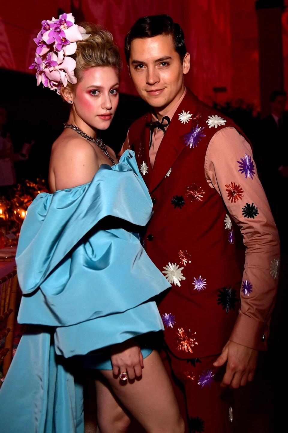 """<p>Though Lili and Cole first met in 2016 while playing occasional lovers Betty and Jughead on <strong><a class=""""link rapid-noclick-resp"""" href=""""https://www.popsugar.co.uk/Riverdale"""" rel=""""nofollow noopener"""" target=""""_blank"""" data-ylk=""""slk:Riverdale"""">Riverdale</a></strong>, they didn't go public with their own romance until 2018. The two dated on and off for two years before finally splitting for good in 2020. Not long after their second and (maybe) final breakup, the former couple began filming season five of their CW series.</p> <p>Back in July 2019 during an interview with <strong>W</strong>, Lili spoke about the grueling hours spent filming and said <a href=""""http://www.wmagazine.com/story/cole-sprouse-lili-reinhart-relationships-riverdale-interview/"""" class=""""link rapid-noclick-resp"""" rel=""""nofollow noopener"""" target=""""_blank"""" data-ylk=""""slk:she couldn't imagine how &quot;miserable&quot; she'd be"""">she couldn't imagine how """"miserable"""" she'd be</a> if she """"hated"""" her fellow cast members. Later, after returning to Vancouver to resume <strong><a class=""""link rapid-noclick-resp"""" href=""""https://www.popsugar.co.uk/Riverdale"""" rel=""""nofollow noopener"""" target=""""_blank"""" data-ylk=""""slk:Riverdale"""">Riverdale</a> </strong>filming in September 2020, Lili told <strong>Nylon</strong> <a href=""""http://www.nylon.com/entertainment/lili-reinhart-interview-swimming-lessons-poetry"""" class=""""link rapid-noclick-resp"""" rel=""""nofollow noopener"""" target=""""_blank"""" data-ylk=""""slk:she felt &quot;like a prisoner&quot;"""">she felt """"like a prisoner""""</a> being stuck in Canada, though she didn't explicitly say that feeling had anything to do with her ex. </p> <p>Not long after, <a href=""""http://www.instagram.com/p/CEFPYvKJDGM/"""" class=""""link rapid-noclick-resp"""" rel=""""nofollow noopener"""" target=""""_blank"""" data-ylk=""""slk:Cole posted an Instagram announced their breakup"""">Cole posted an Instagram announced their breakup</a>, saying he wished Lili the """"utmost love and happiness moving forward."""" </p>"""