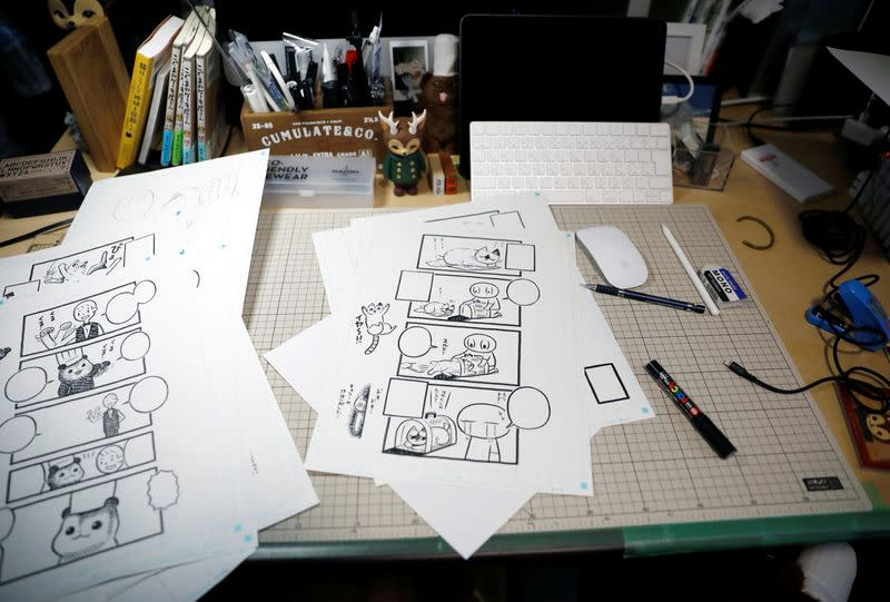 Sheets with four-panel strip comic 'Koguma's Cake Shop' are seen at his workspace in Tokyo