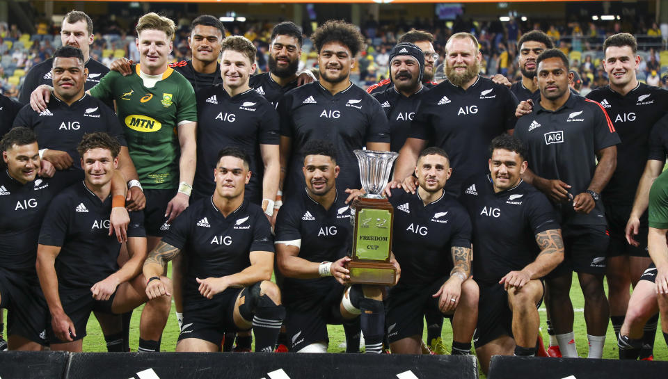 The All Blacks pose with the Freedom Cup after defeating the Springboks in their Rugby Championship test match in Townsville, Australia, Saturday, Sept. 25, 2021. (AP Photo/Tertius Pickard)