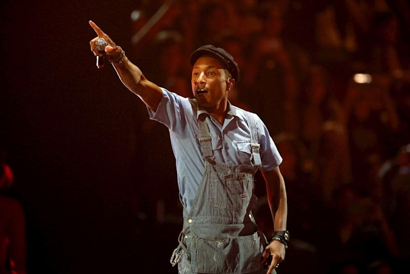 Pharrell Williams performs his song 'Freedom' at the 2015 MTV Europe Music Awards, or EMAs, at Mediolanum Forum in Milan, on October 25, 2015 (AFP Photo/Hubert Boesl)