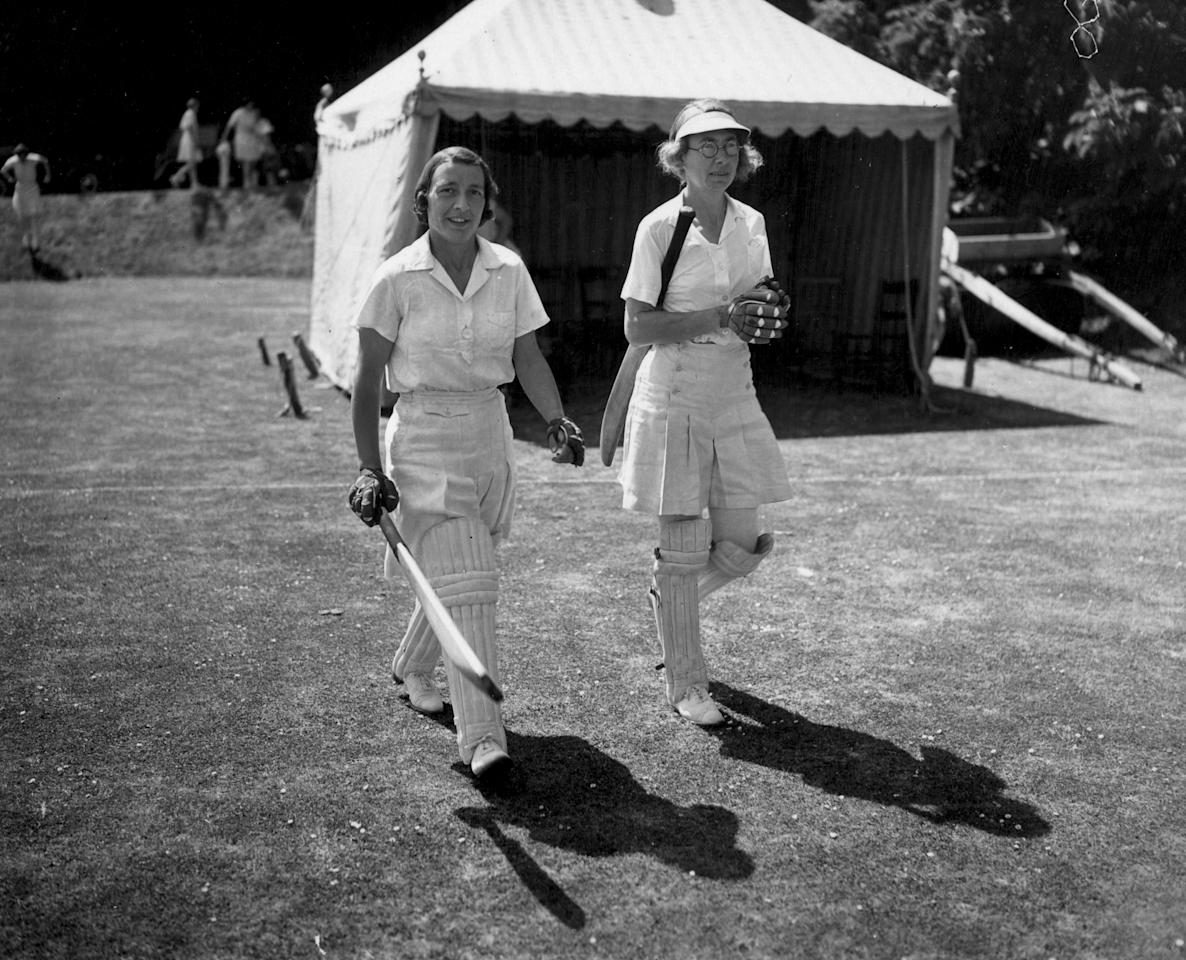 10th June 1939:  Cricketers Betty Snowball (left), wicket-keeper for England, and T Dutton walking on to opening the batting at a match at Arundel Castle in Sussex.  (Photo by David Savill/Topical Press Agency/Getty Images)