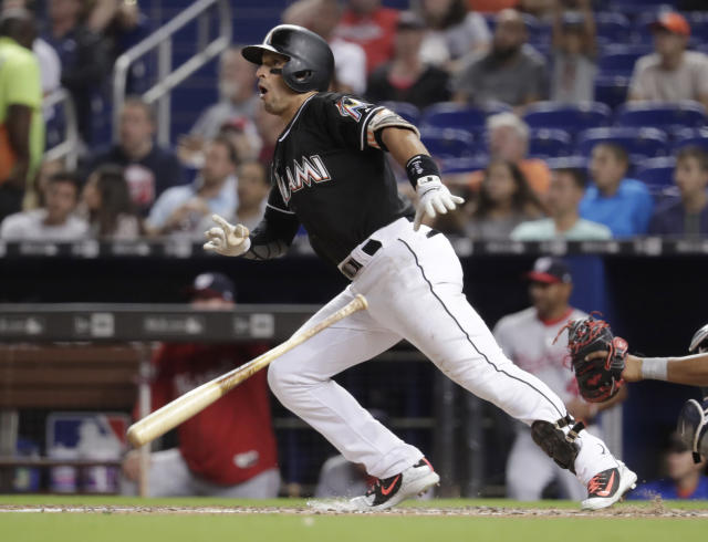 Miami Marlins' Martin Prado hits a double during the third inning of a baseball game against the Washington Nationals, Friday, May 25, 2018, in Miami. (AP Photo/Lynne Sladky)