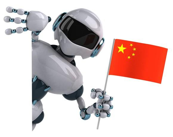 A robot holding a Chinese flag.
