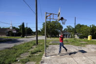 In this Sunday, June 7, 2020, photo, Brent Williams plays basketball in Houston's Third Ward. George Floyd, who grew up in the Third Ward and had a passion for basketball, died after being restrained by Minneapolis Police officers on Memorial Day. (AP Photo/David J. Phillip)